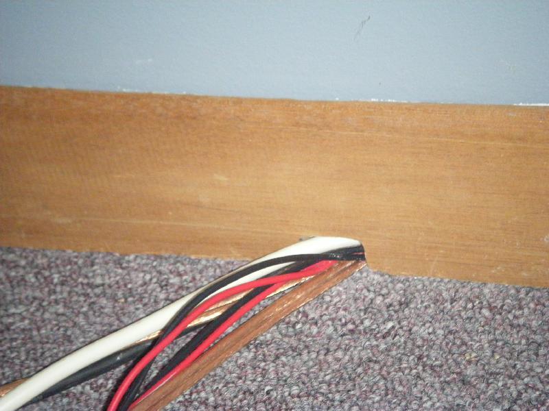 Material to camoflouge speaker wire?-baseboard3.jpg