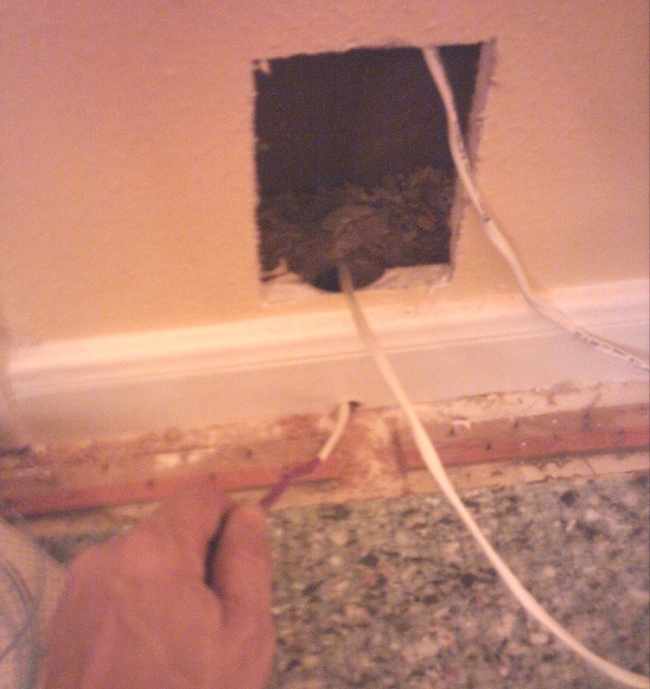 How to: In-Wall Wiring for Your Home Studio-pulling-wire-through-baseboard-.jpg