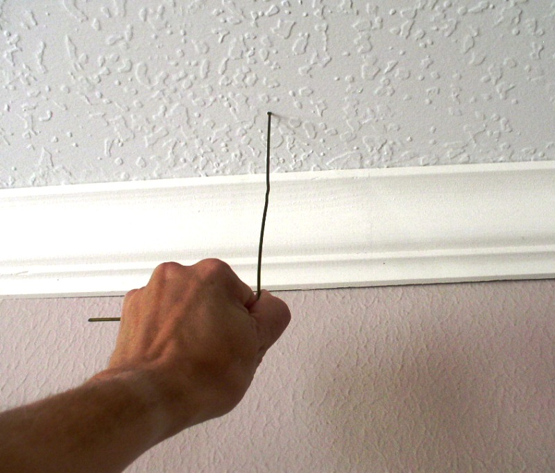 How to: In-Wall Wiring for Your Home Studio-pushing-wire-into-ceiling.jpg